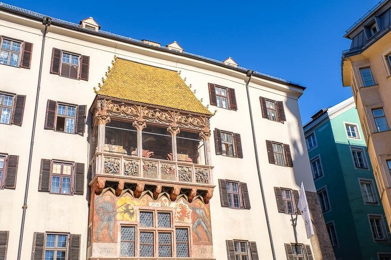 golden roof over balcony on white old building in innsbruck old town