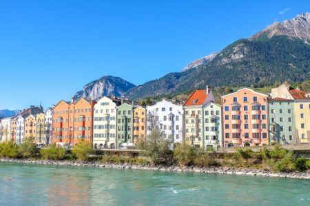 colourful houses by river bank where to stay in innsbruck austria