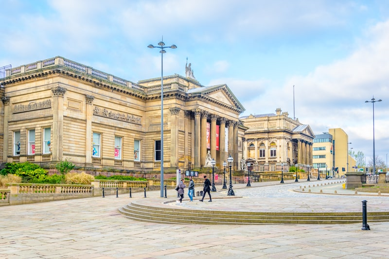 large museum building with cobblestone in front in liverpool