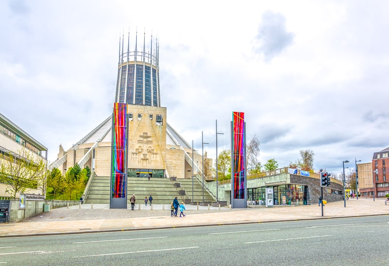 large cathedral building in liverpool with road in front