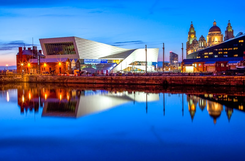 modern museum of liverpool with reflection in water