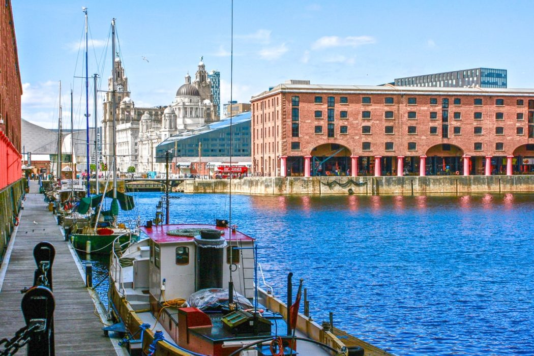 red brick pier building with boat in water things to do in liverpool