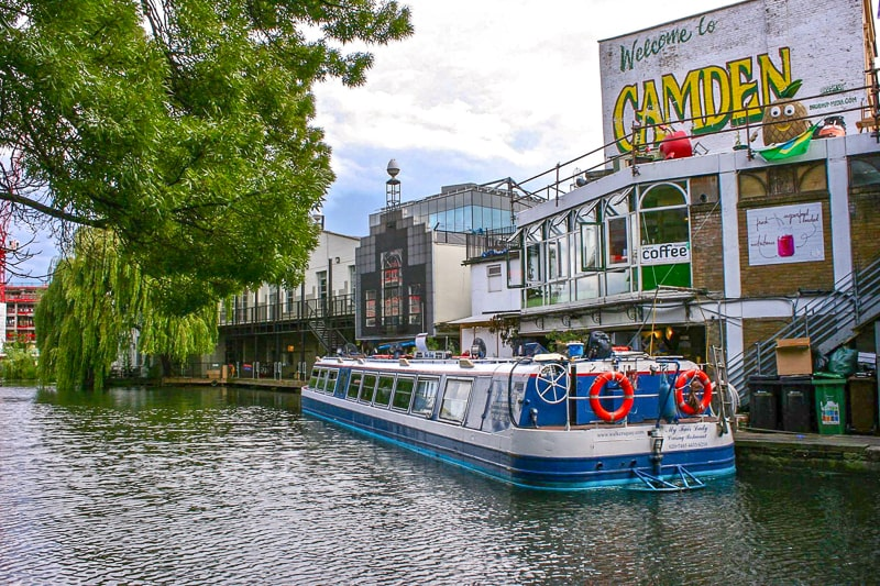 large boat on water outside camden market in london