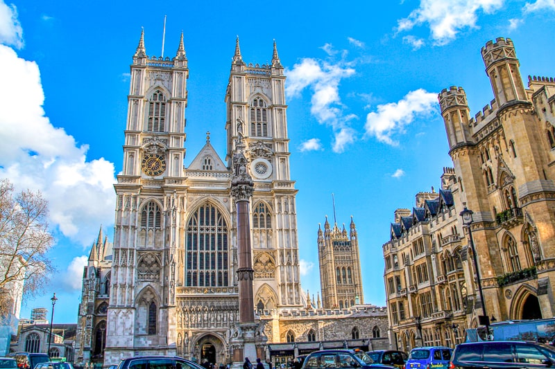 tall church towers in central london westminster abbey with blue sky behind