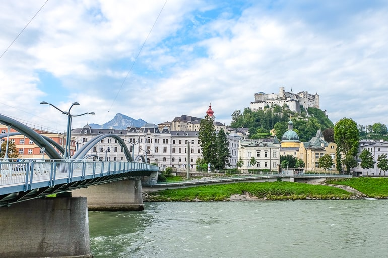 castle on hill with river below and bridge on left in salzburg