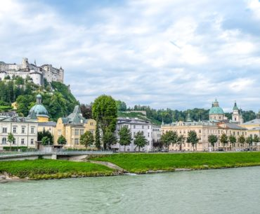 castle on hill with old town and river below thing to do in salzburg austria